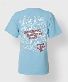 "This 100% cotton blue Comfort Color shirt reads in hand lettering on the back ""Texas A&M University, College Station, Texas. Est. 1876, Gig 'Em Aggies"". The front has maroon block ATM."