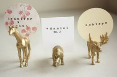 Love these place card holders = all it takes is plastic toys and gold spray paint. Fun way to display name cards Handmade Wedding, Diy Wedding, Wedding Day, Wedding Flowers, Wedding Places, Wedding Place Cards, Wedding Place Card Holders, Wedding Programs, Wedding Venues
