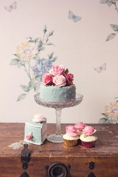Blue cake topped with pink roses
