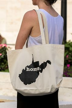 The Home. T - West Virginia Home Tote Bag. Portion of profit donated to multiple sclerosis research.