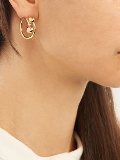 Double-sphere gold-plated hoop earrings | J.W.Anderson. Available here: http://rstyle.me/n/cfe8mzbcukx