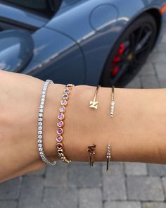 From left to right: Diamond Tennis Bracelet, Rainbow Tennis Bracelet, Double Letter Bangle,