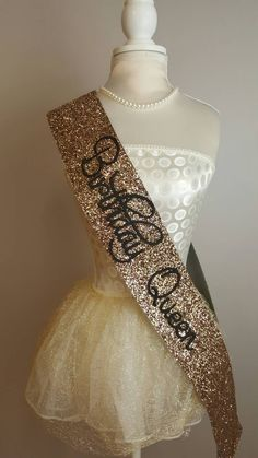 Beautiful handmade gold glitter Birthday Sash  There are colour choices for this product;black, Silver, gold and pink Please ensure that you select the correct choice before ordering.  Please see our shop for other options in sashes - bachelorette party, hen party etc.  Please note - These are handmade made from a heavy glitter material and may vary in shape/ size.  DELIVERY SCHEDULE The following postage times are in addition to manufacturing times. - UK orders are shipped via Royal Mail…