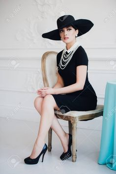 Elegant woman in black dress with a hat sitting on chair by romankosolapov. Elegant woman in black dress with a hat sitting on a chair. Sitting Pose Reference, Human Poses Reference, Pose Reference Photo, Art Poses, Portrait Poses, Female Portrait, Portraits, Chair Photography, Photography Women