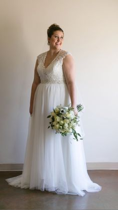 This sleeveless wedding gown can be made with any design changes you need.  We make custom plus size wedding dresses for brides that you can customize. We also can make  #replicadresses for brides who love an expensive design but it is out of their price range.  Your custom bridal gown will look similar in style but cost way less.  Get pricing on custom wedding dresses & replicas when you visit www.DariusCordell.com