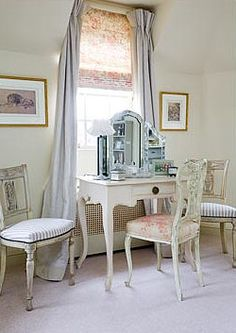 Vintage vanity & chairs with a white washed finish. Perfect in front of a sunny window!