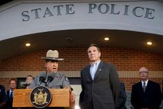 New York State Police Superintendent Joseph D'Amico, left, and Gov. Andrew Cuomo speak to members of... - Mary Altaffer/AP Photo