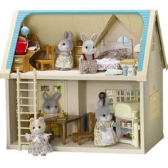 Sylvanian Families Applewood Cottage. Cottontail Rabbit Family and Maroon Dog Family.