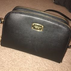 Michael Kors Purse Black crossbody purse with gold detailing. Barely used Michael Kors Bags