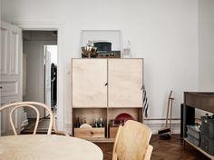 plywood cabinet warm minimalist apartment