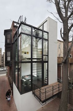 Idea: glass up an ugly exterior of a house with steel and glass