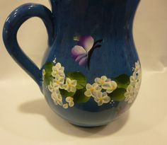 Hand Painted Denim Blue Ceramic Pitcher Spring White Flowers Hydrangeas Daisies Lavender Butterflies by bunnyhutchdesigns on Etsy