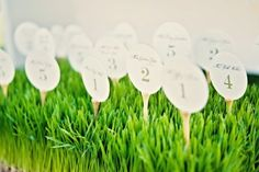 golf ball escort cards - use textured paper to look more like golf balls