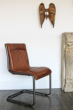 This chair is simply beautiful It is made in the softest brown padded leather and strong industrial steel The look is vintage and the style timeless