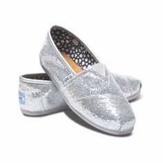 TOMS Classic Canvas Shoes Silver Glitter Great condition. Minor wear on shoes. Unnoticeable when worn. TOMS Shoes