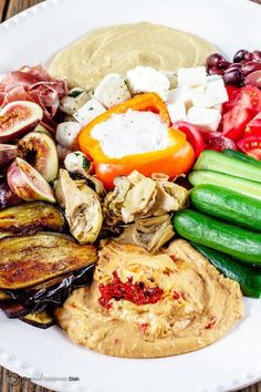 How to Build the Perfect Mediterranean Party Platter - Ditch boring party platters and try this no-cook, impressive Mediterranean mezze platter. With Sabra hummus, yogurt dip, veggies, olives, cheeses, and more! Pin it for your next party! | themediterraneandish.com