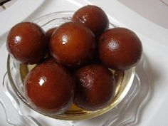 Gulab jamun is a milk-solids based dessert soaked in a syrup.