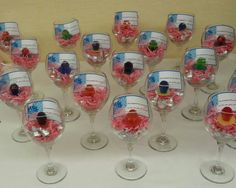 """Easy inexpensive bridal shower favors! Large wine glasses filled with accordion paper pieces,  Hershey kisses and a ring pop. Top off with a little photo paper tag that says """"he popped the question,  so ill see you at the kiss"""""""