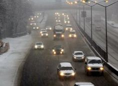 NEW YORK, NY - FEBRUARY 03: Cars travel down a highway during a snowstorm in the Brooklyn borough on February 3, 2014 in New York City. The metro area is expecting 5 to 8 inches of snow by the evening, making for a treacherous rush hour and delaying many flights to airports. (Photo by Spencer Platt/Getty Images)