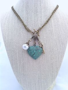 """Interchangeable Charm Necklace by TheRestlessSpirit on Etsy, $18.00. Comes with convertible chain (20"""" toggled, 40"""" opened) and 3 charms of your choice."""