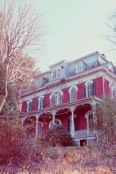 A wonderful turn of the century home with lots of charm... with a Mansard Roof style roof... which I adore.