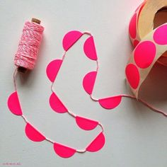 Easy and pretty DIY streamer.  Kids can do.  Need only string and adhesive circles.