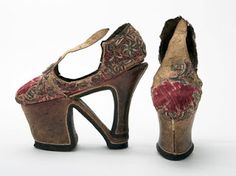 "Shoes: ca. 17th century, Swedish (on loan from Skoloster Castle, Sweden). ""The architecture of this shoe is highly idiosyncratic. The shoemaker made a sole by combining elements of a chopine with a high heel and he made an upper that combines a shoe and a mule. It seems that the shoemaker was attempting to merge the extreme elevation offered by the chopine with the up-to-the-minute fashion of high heels. The resultant shoes are a remarkable statement of ostentatious display."""