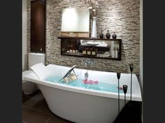 Bath: Super-deep stand-alone tub, photo by Brandon Barré Photography.