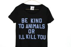 BE KIND TO ANIMALS OR ILL KILL YOU +  black jersey tshirt with felt iron on baby blue lettering.    womens size small  measurements_  bust- 34 inches