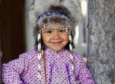Photo of Eskimo girl wearing an Alaskan Native headdress and kuspuk in Eagle River, Southcentral Alaska in Summer.