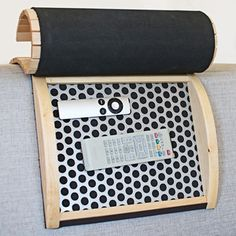 Armadilla over the couch remote storage. Absolutely beautiful way to use wood as storage.