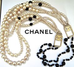 Chanel 4 strands 2- ways golden coloured pearl and black glass bead necklace. From 2003P. In pristine condition. **THIS signed massive and substantial  four graduating strands is a rare piece. Done with very high quality luscious gold colored glaze heavy glass pearls and glass black beads that vary in size ( 6mm- 14mm ).  ***  Designed to be worn in 2 ways ( pls refer to photo # 1 and #2  ) : Conventionally and criss-crossed on the body as shown in runway pictures.