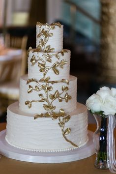 White Wedding Cake with Gold Leaf | photography by http://emiliajanephotography.com