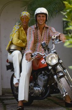 Socialite Bikers (© Slim Aarons):  April 1970: Mr and Mrs Harry Loy Anderson Jnr ready for a motorbike ride, Palm Beach, Florida.