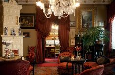 """The drawing room looking toward the men's room. The furniture, curtains and portières, together with the room's ornamentation, date to The s-shaped sofa is typical of the late century date, and is known as a """"tête à tête"""" or """"conversati Old Mansions Interior, Luxury Homes Interior, Gothic Mansion, Drawing Room, Victorian Homes, Victorian Era, Vintage Home Decor, Old Houses, New Homes"""