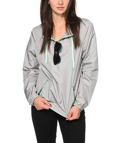 The pullover design of this windbreaker jacket is perfect for layering, while the lightweight polyester construction protects from the elements so you can look your best rain or shine.