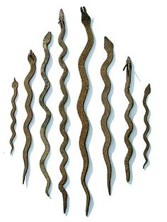 Used by the Lobi Tribe in Burkina Faso, these iron snakes were used and recognized as currency for transactions. They would also tie them to their calves to protect them from snake bites and lightning.