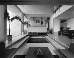 mid century modern- love the sunken living room. Cover the steps in comfy cushions, add a cool retro mini bar and voila!