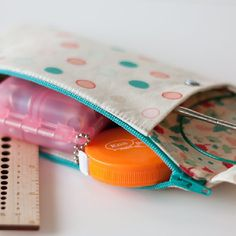 Free sewing tutorial for storing both knitting needles & notions in 1 cute pouch! Works great for makeup & brushes too!
