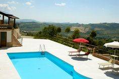 A beautiful view from the pool over the sloping hills.