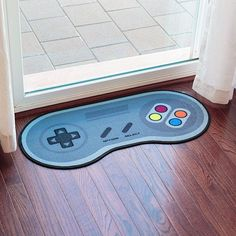 More Nintendo love, this time with the Game Controller Doormat at ThinkGeek. Not that it says Nintendo or the console in question that used this Super Nintendo, Geek Mode, Video Game Bedroom, Bedroom Games, Diy Bedroom, Deco Gamer, Geek Decor, Classic Video Games, 16 Bit