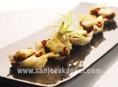 Mixed Sprouts Cups Recipe - Spicy mixed sprouts baked in spring roll wrappers.