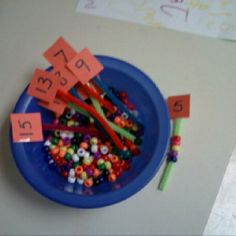 Pipe cleaners cut short with a number taped to the end.  Have the kids feed the same number of pony beads onto the pipe cleaners. (Free idea!)