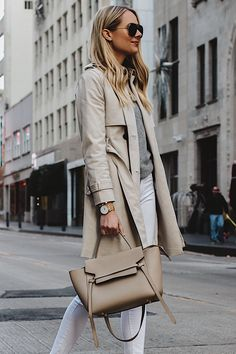 68875139e6 Blonde Woman Wearing Club Monaco Trench Coat Grey Sweater White Skinny  Jeans Celine Belt Bag Fashion