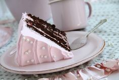 Vintage Cake  This amazing chocolate cake is filled with a raspberry mousse and covered in a French meringue frosting…