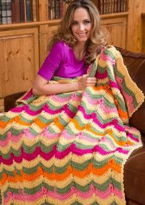 This Pockets Full of Posies Throw is perfect for spring and summer. With rich pastel colors this free crochet afghan pattern will add a chic touch to your home.