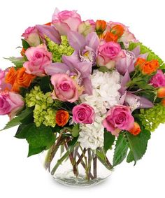 Sunny Sorbet - This showstopping arrangement is designed in a large bubble bowl. Included in the assortment are cymbidium orchids, roses hydrangea and more. #KittelbergerFlorist #RochesterFlowers