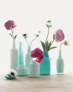 Empty bottles with a little paint create a beautiful and colorful collection for a party!
