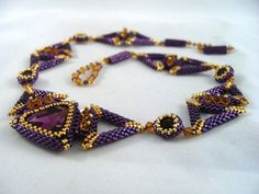 Triangulations  Beaded Necklace by ChristmasCreation on Etsy, $220.00