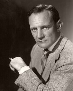 British actor Trevor Howard smokes a cigarette. Howard is dressed in a herringbone jacket and Cardiff, Hollywood Stars, Classic Hollywood, Trevor Howard, Brief Encounter, Actor Studio, Screen Film, Television Program, Iconic Movies